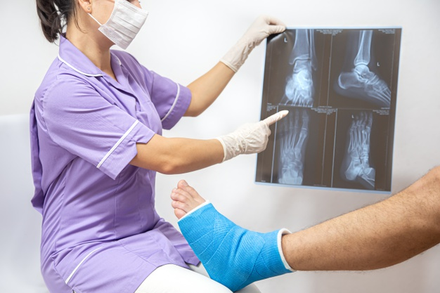 bone-fracture-foot-leg-male-patient-being-examined-by-woman-doctor-hospital-chrysa-vafeiadi-physio