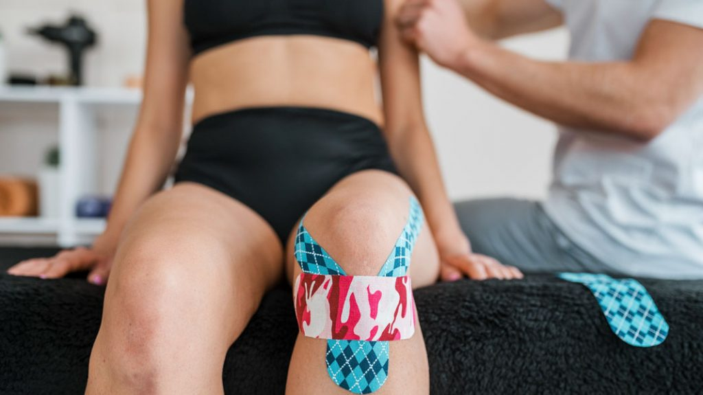 female-patient-physiotherapy-with-knee-brace-tape-chrysa-vafeiadi-physio