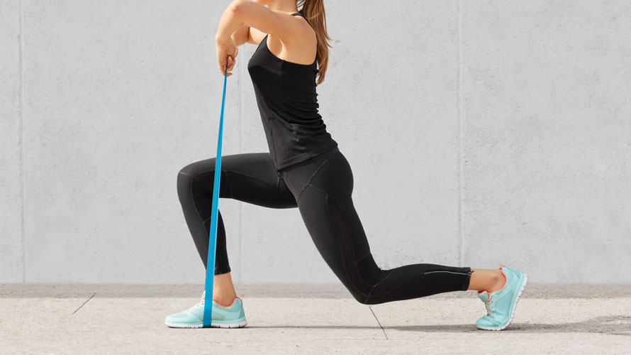self-determined-bodybuilder-does-exercises-with-rubber-band-works-hands-legs-wears-comfortable-sneakers-sportsclothes-chrysa-vafeidi-physio